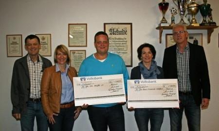Spendenübergabe an die Fördervereine der Kita Wolsfeld (Thomas Peters) und der Grundschule Wolsfeld (Andrea Neu-Zahren)